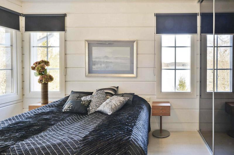 omakotitalo-hirsitalo-makuuhuone