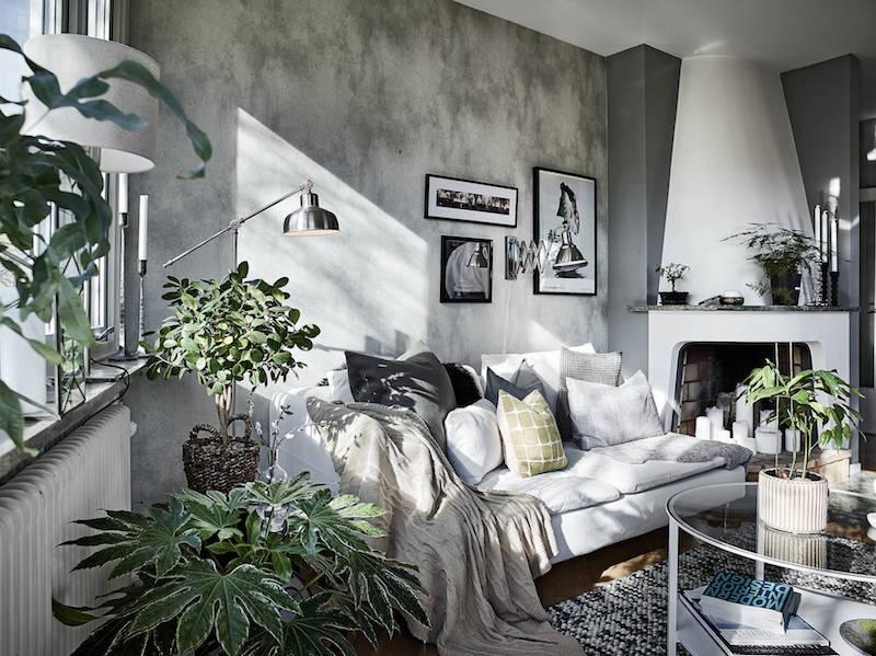 olohuone-harmaa-seina-persoonallinen-kodikas-sisustus