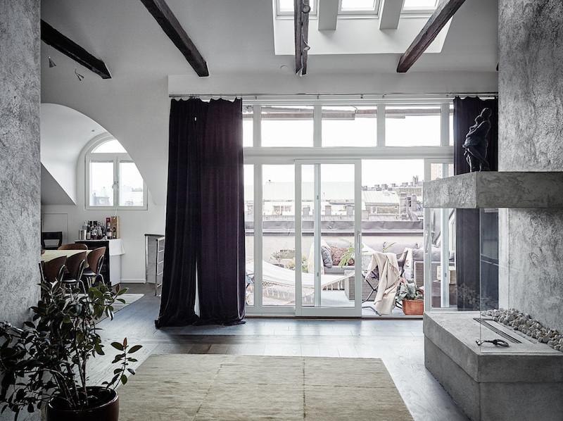 ylellinen-kattohuoneisto-takka